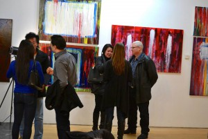Friends talking at the group exhibition